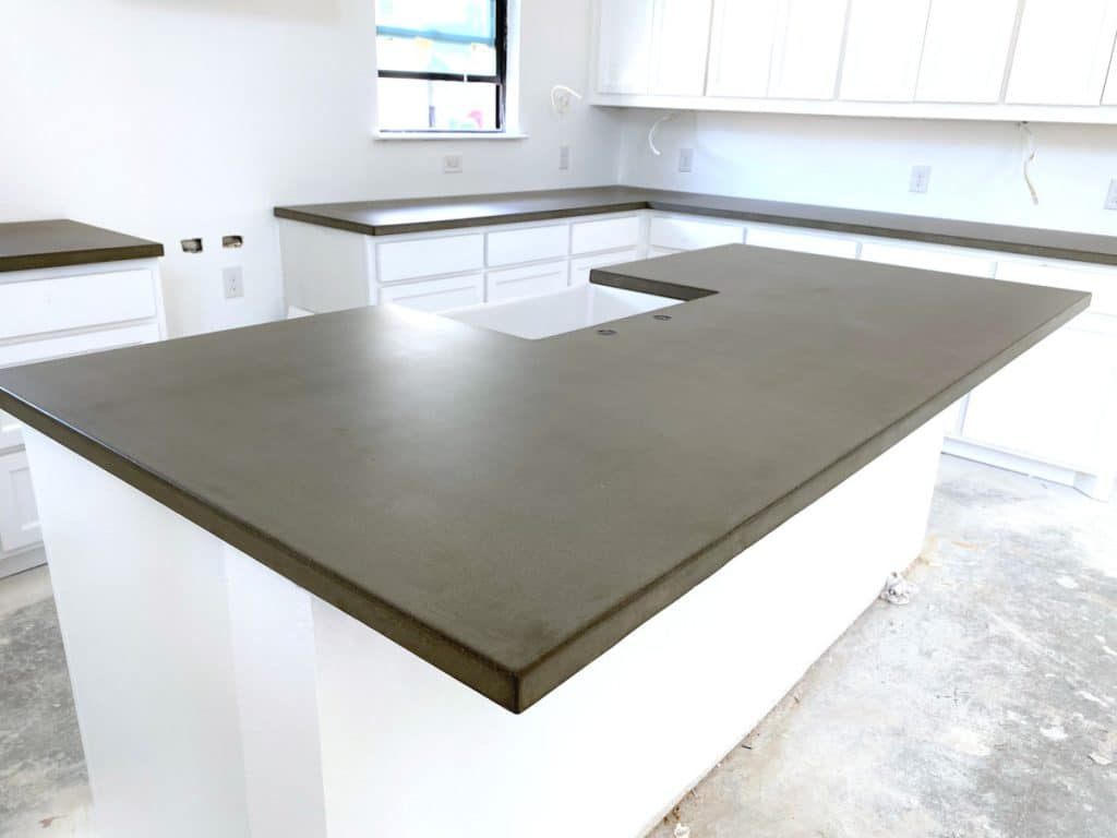Our Plain Grey Concrete Countertops Give a Great Contrast to All of the White in The Kitchen!