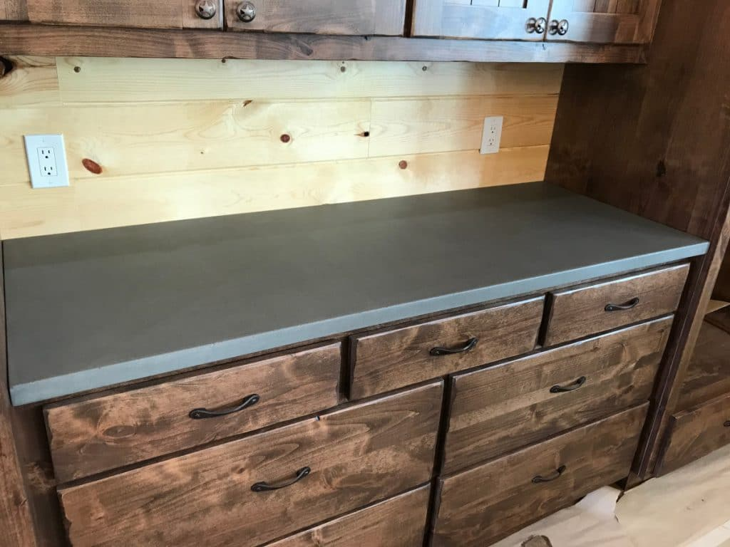 Our plain grey concrete countertop complements these cabinets perfectly!