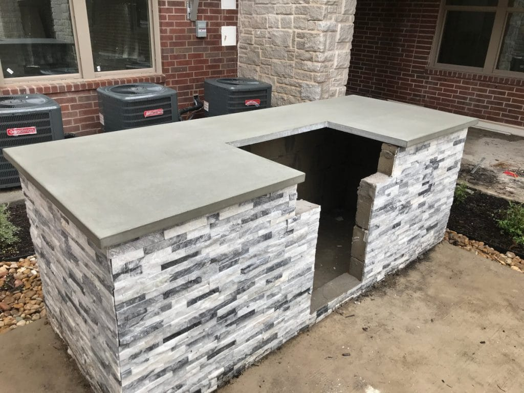 Grey concrete countertop we installed at an apartment complex for El Dorado Pools