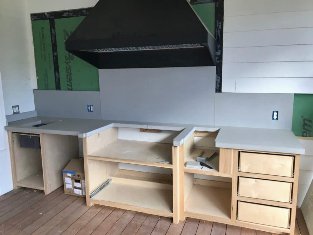 Light grey concrete countertops and backsplash we installed for this outdoor kitchen in Sulpher Springs, Tx