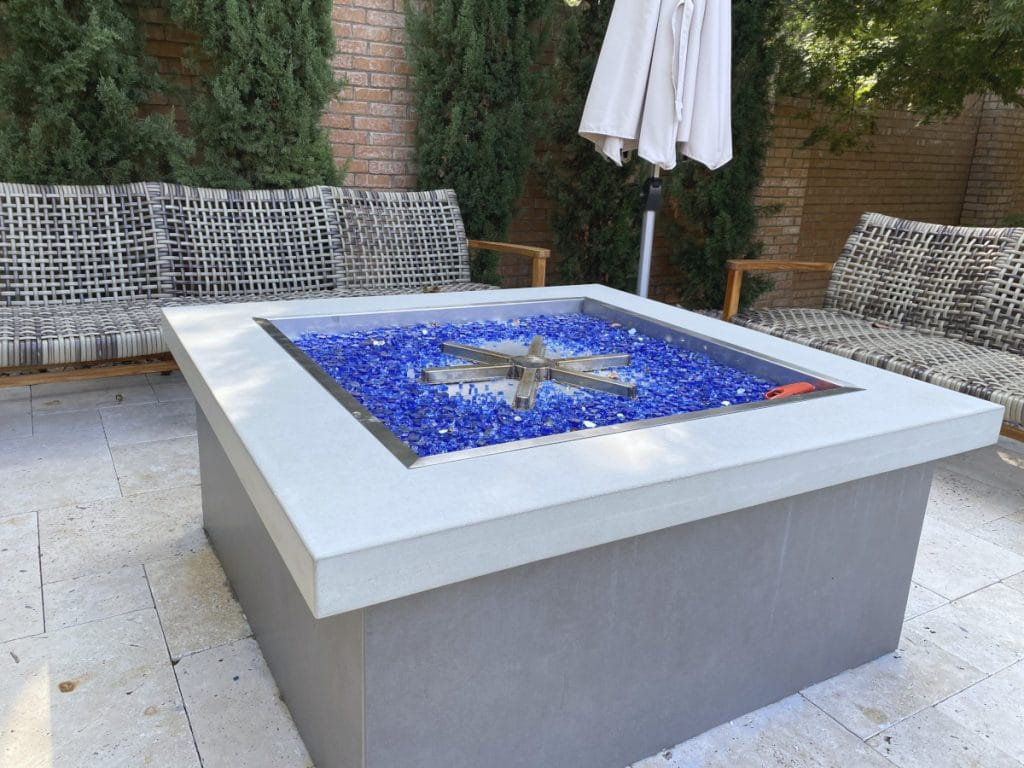 Custom Light Grey Concrete Firepit Surround for a backyard in Mckinney, Tx