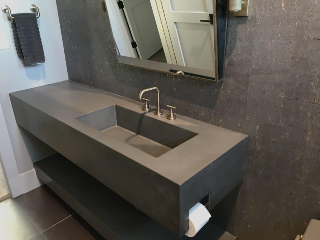 Large Floating concrete vanity with integral sink and toiled paper holder