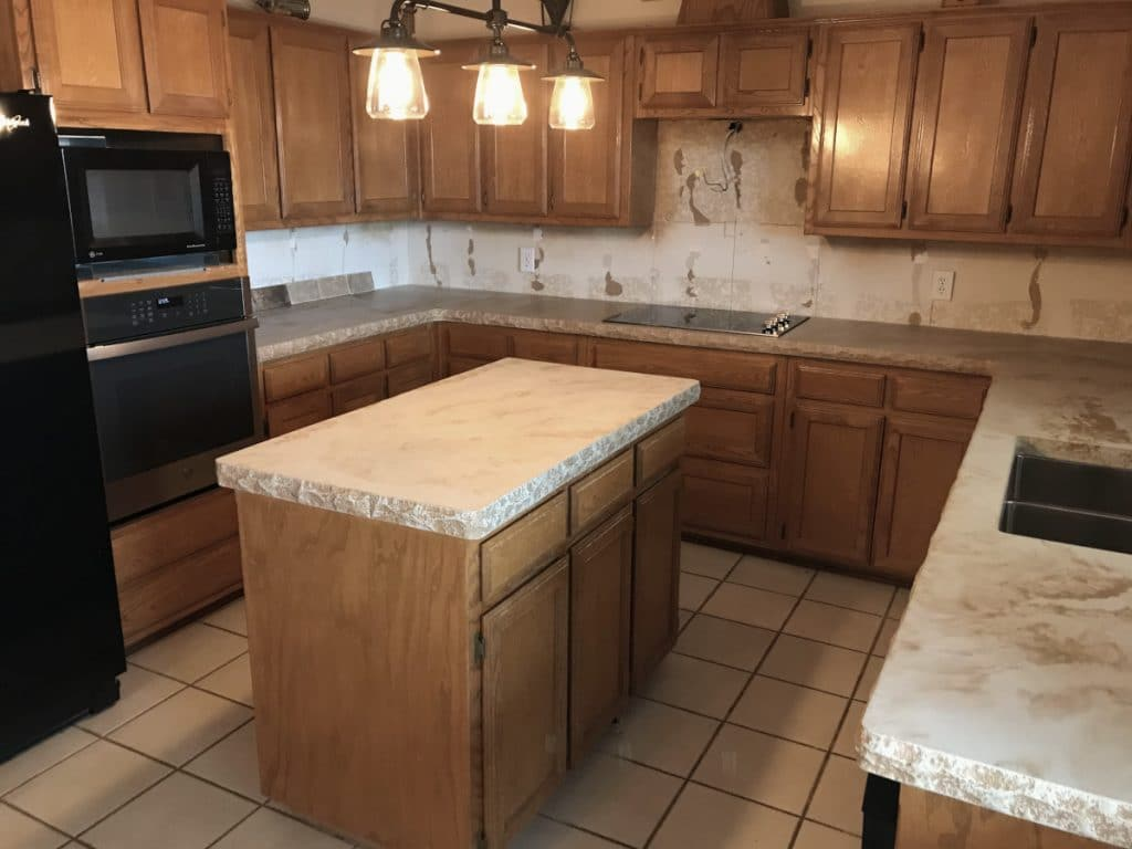 Pictures of a beautiful kitchen with tan and brown marbled concrete countertops. All of the countertops also have the chiseled edge option.