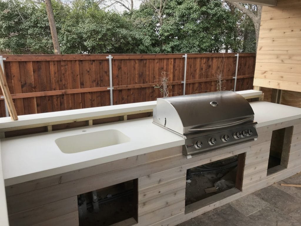 Large Outdoor Kitchen with White Concrete Countertops with Concrete Sink