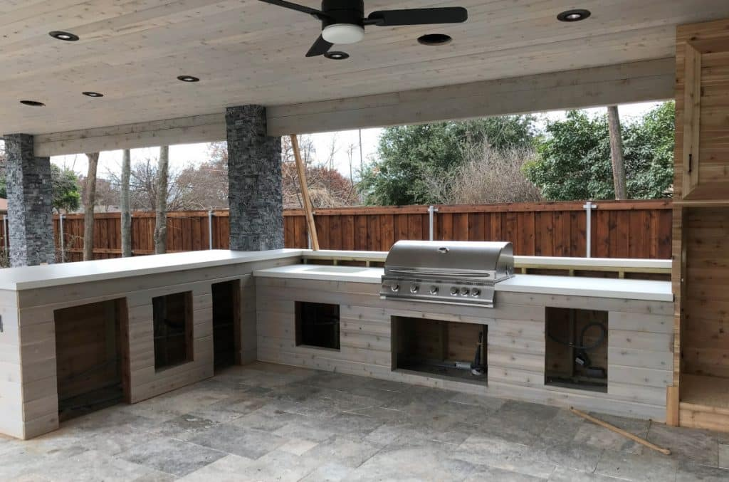 White concrete countertops we installed for this large Hauk Custom Pools outdoor kitchen