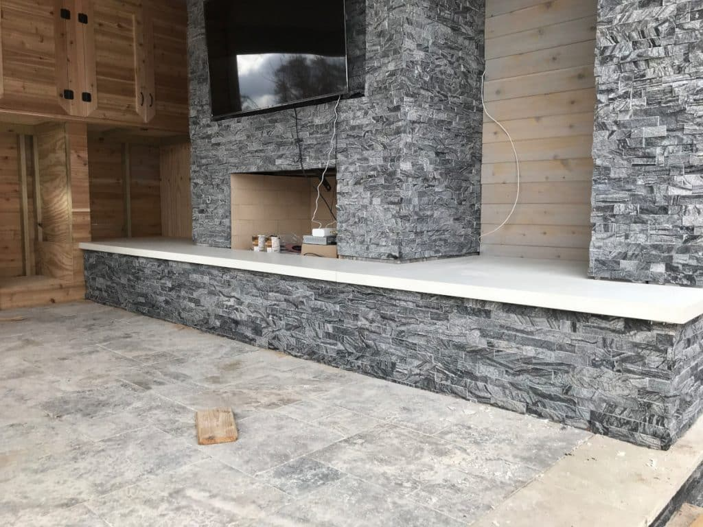 Concrete Fireplace Hearth For an Outdoor Living Area