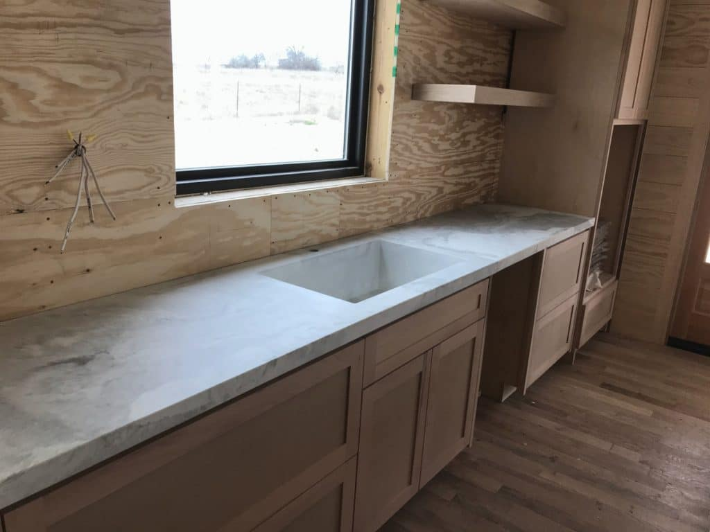 Great look at the integral concrete kitchen sink and the rest of the countertop.