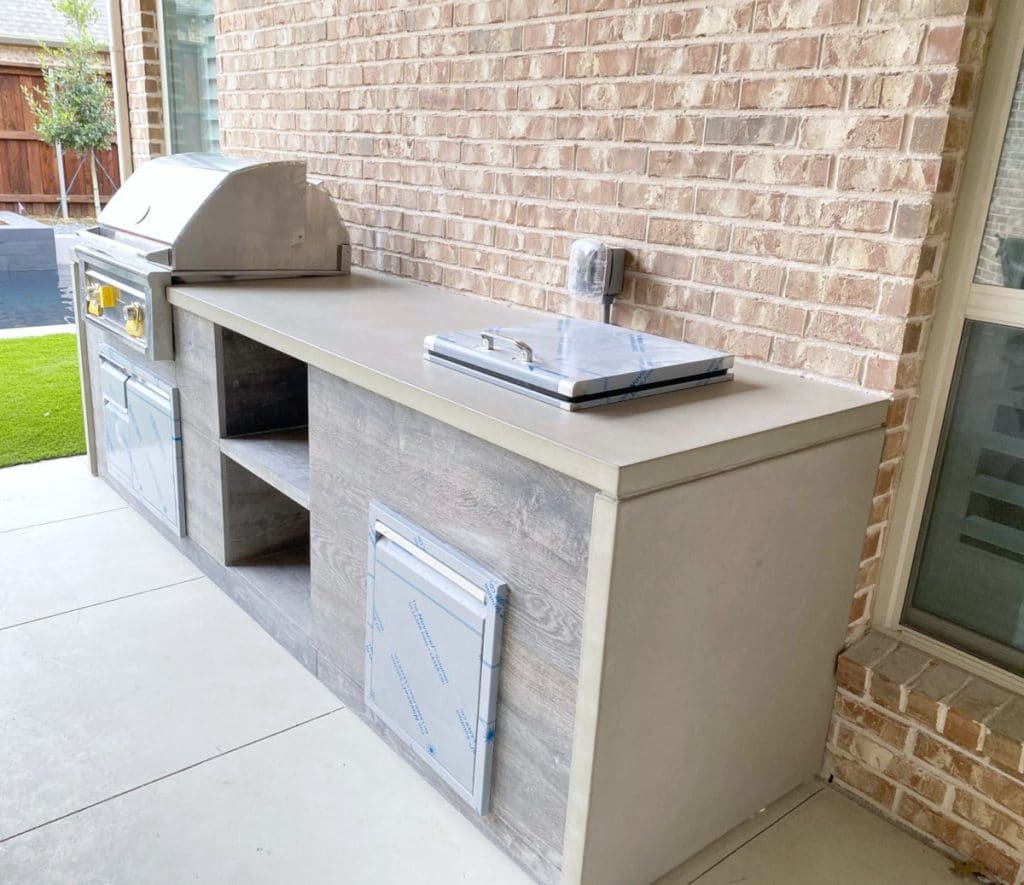 Light Grey Concrete Countertops with Waterfall Panels