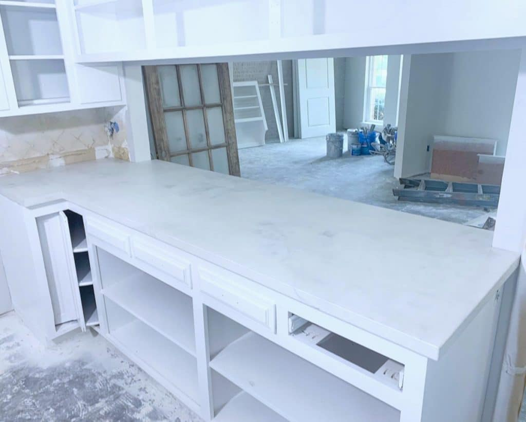 Our White Marbled Concrete on Top of White Cabinetry