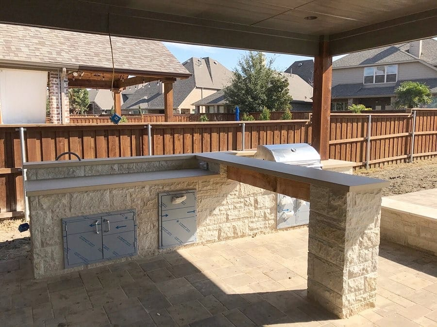 Tan concrete countertops we made for this unique Hauk Custom Pools outdoor kitchen