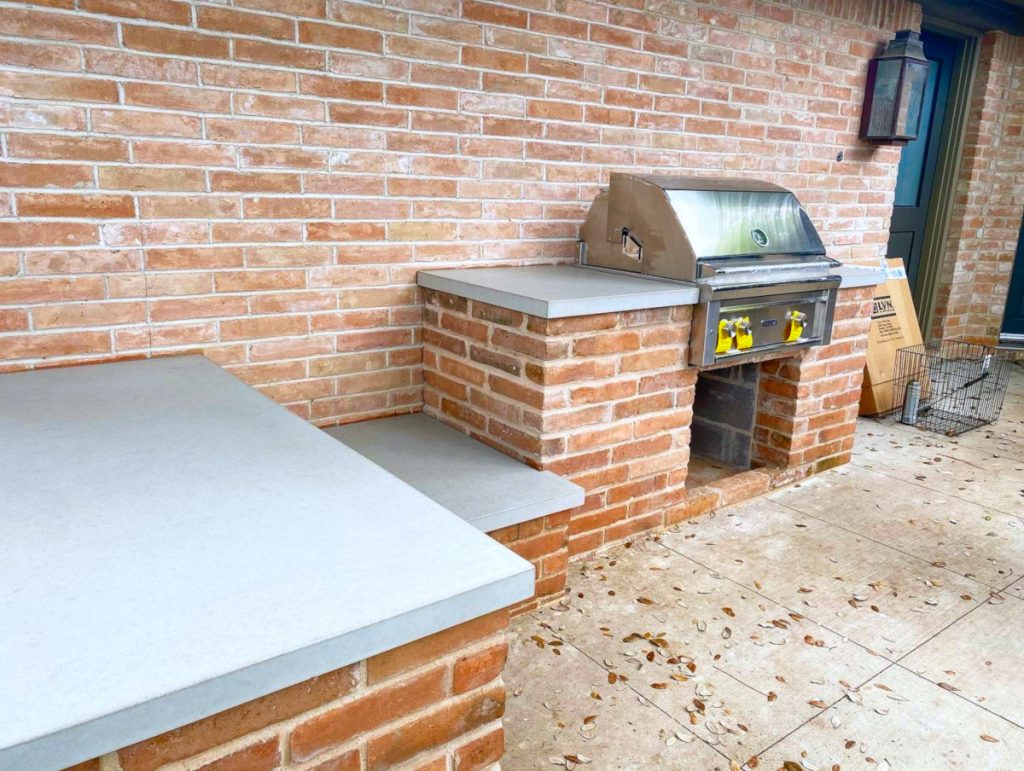 Light Grey Countertops on Orange Brick For An Outdoor Kitchen