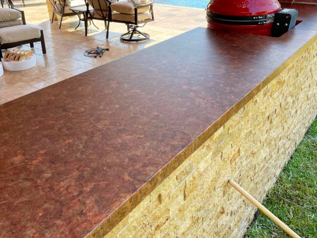 Close up of the reddish brown concrete countertops