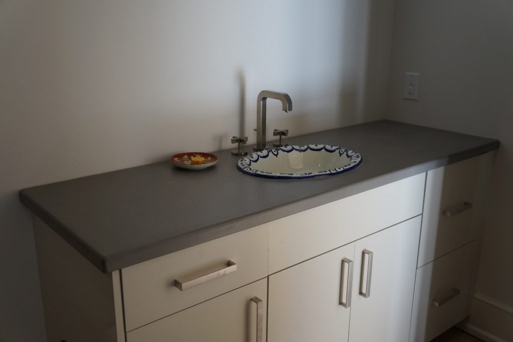 Grey Concrete Bathroom Countertop with overmount sink. Installed in Ft. Worth, Texas for David Lewis Builders