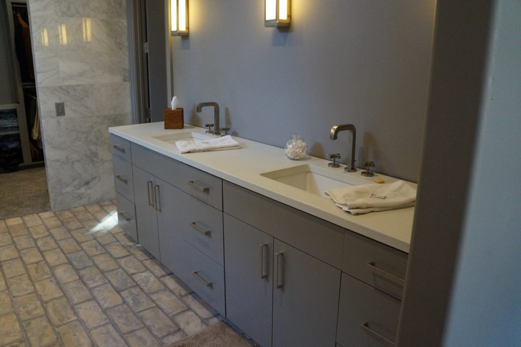 White Concrete Countertop in a bathroom with undermount sinks. This job was installed in Ft. Worth, Texas for David Lewis Builders
