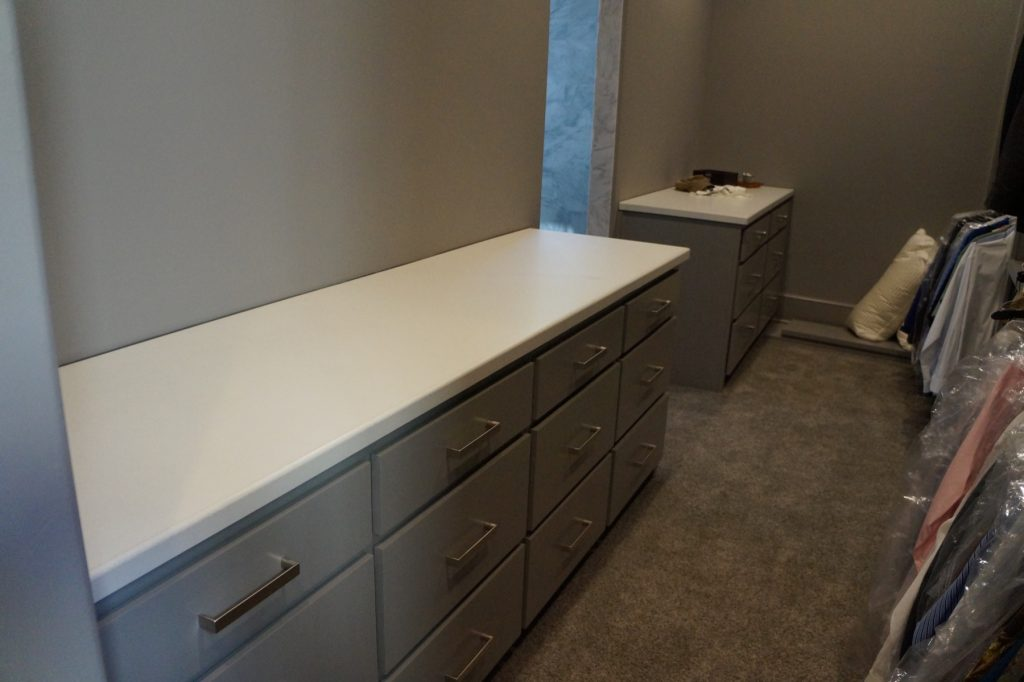 White Concrete Countertops in a closet, installed in Ft. Worth, Texas for David Lewis Builders
