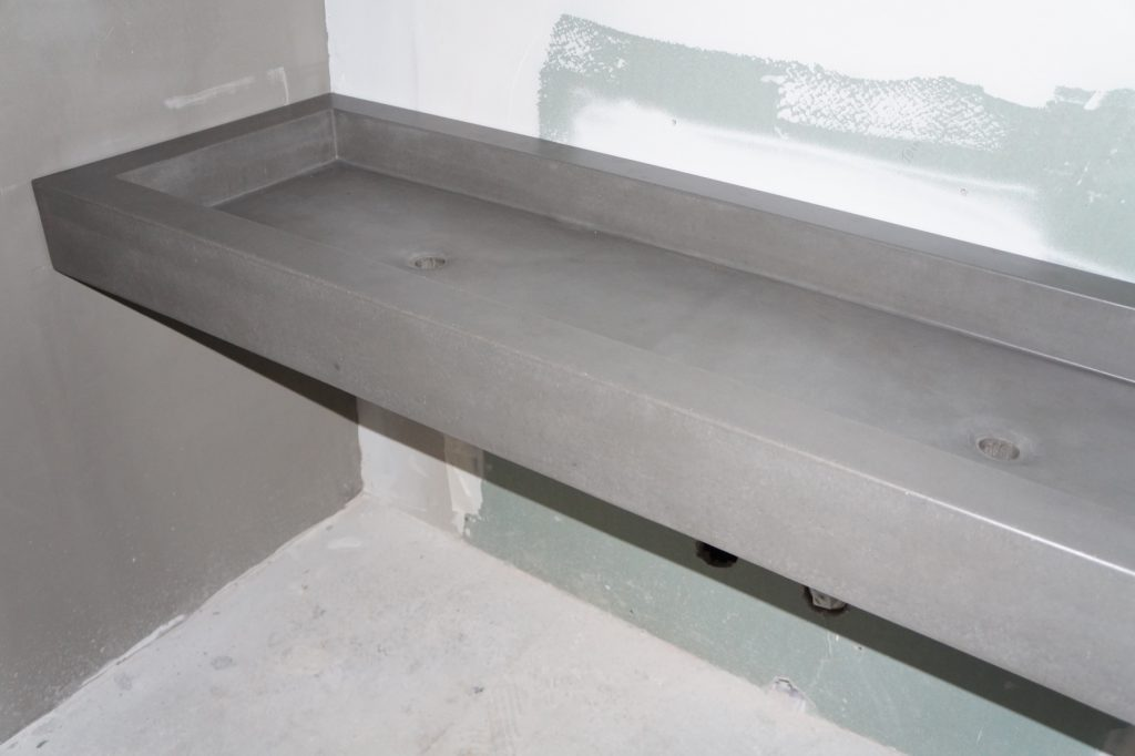 Concrete floating sink installed in a restaurant in Carrollton, Texas. The actual sink is 60 inches wide with two drain holes.