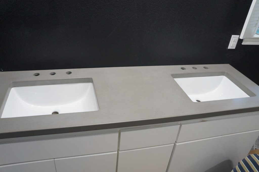 Gray Concrete Bathroom Countertop with white undermount sinks, installed in Dallas, Texas