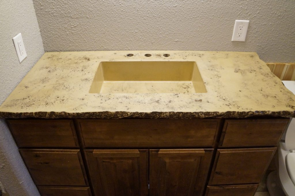 Tan with dark brown fill Concrete Vanity top with rectangular sink installed in Krugerville, Texas