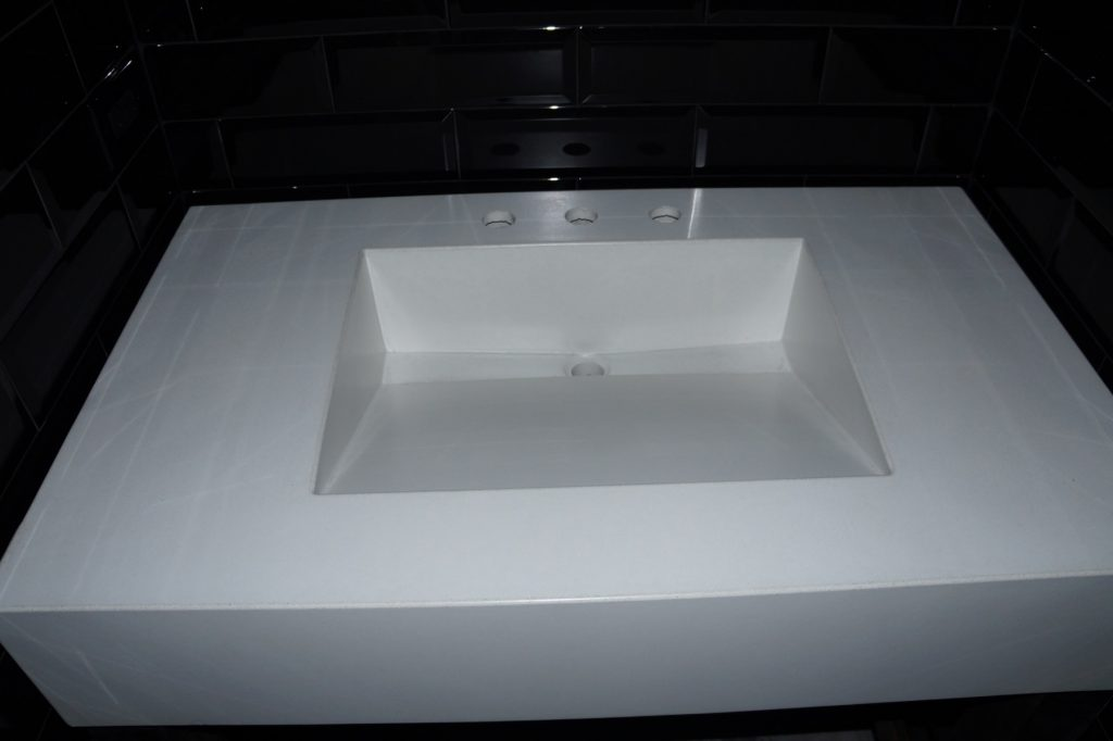 White Concrete Countertop Sink with a Ramp Sink. Installed in Plano, Texas