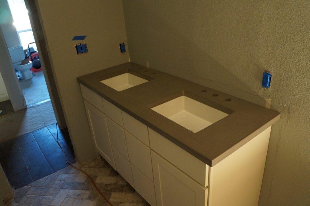 Bathroom Concrete Countertop with undermount sinks installed in Flower Mound, Texas