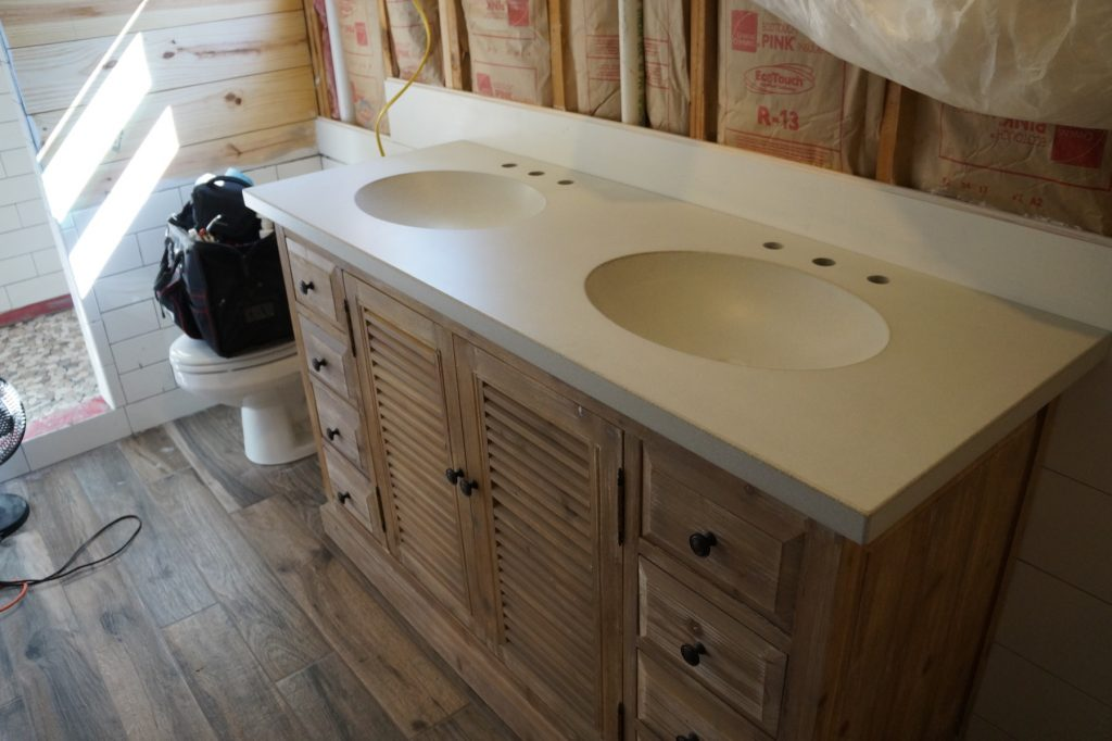 This is what we call our Dirty White colored concrete countertops with two oval, integral sinks. This was installed in McKinney, Texas.