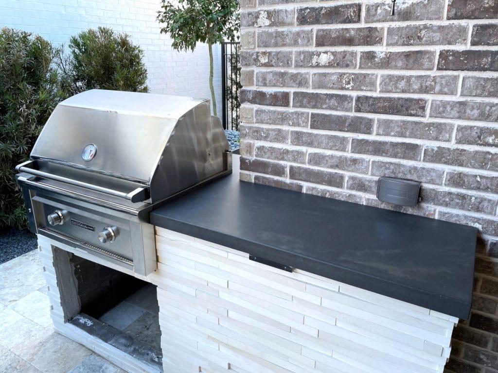 dark grey swirled concrete countertop for outdoor kitchen in Frisco, Tx
