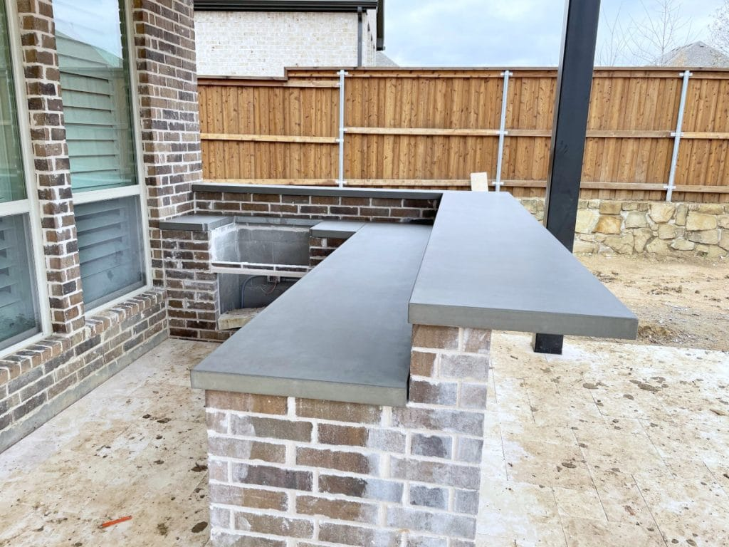 Multi level outdoor kitchen with concrete countertops