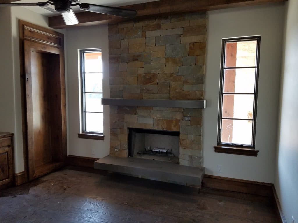 Custom floating concrete fireplace hearth and mantle for a home in Mckinney, Tx