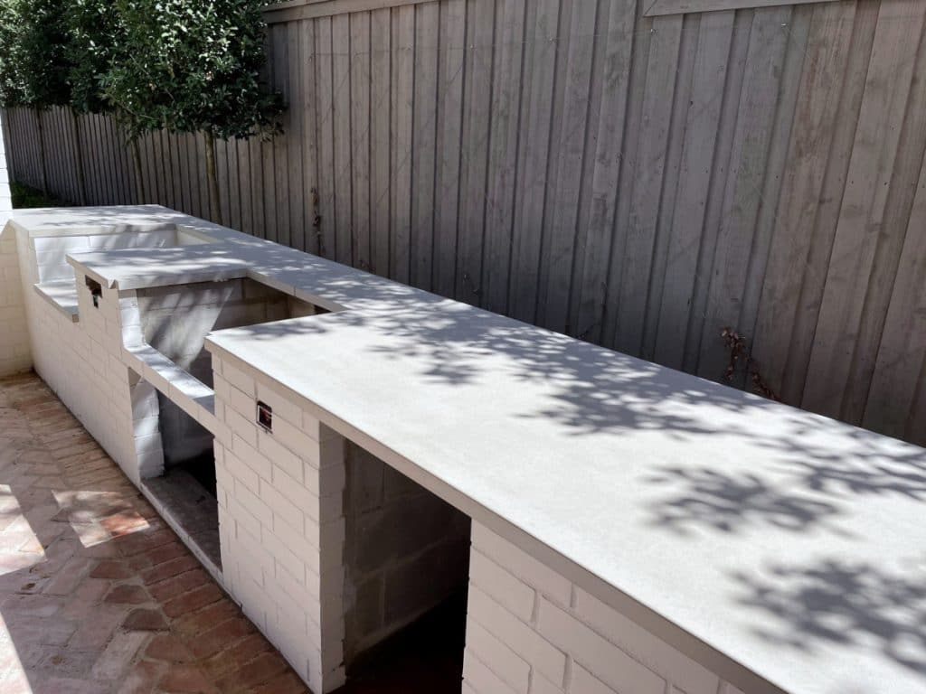 Light grey concrete countertops for a large outdoor kitchen in Dallas, Tx