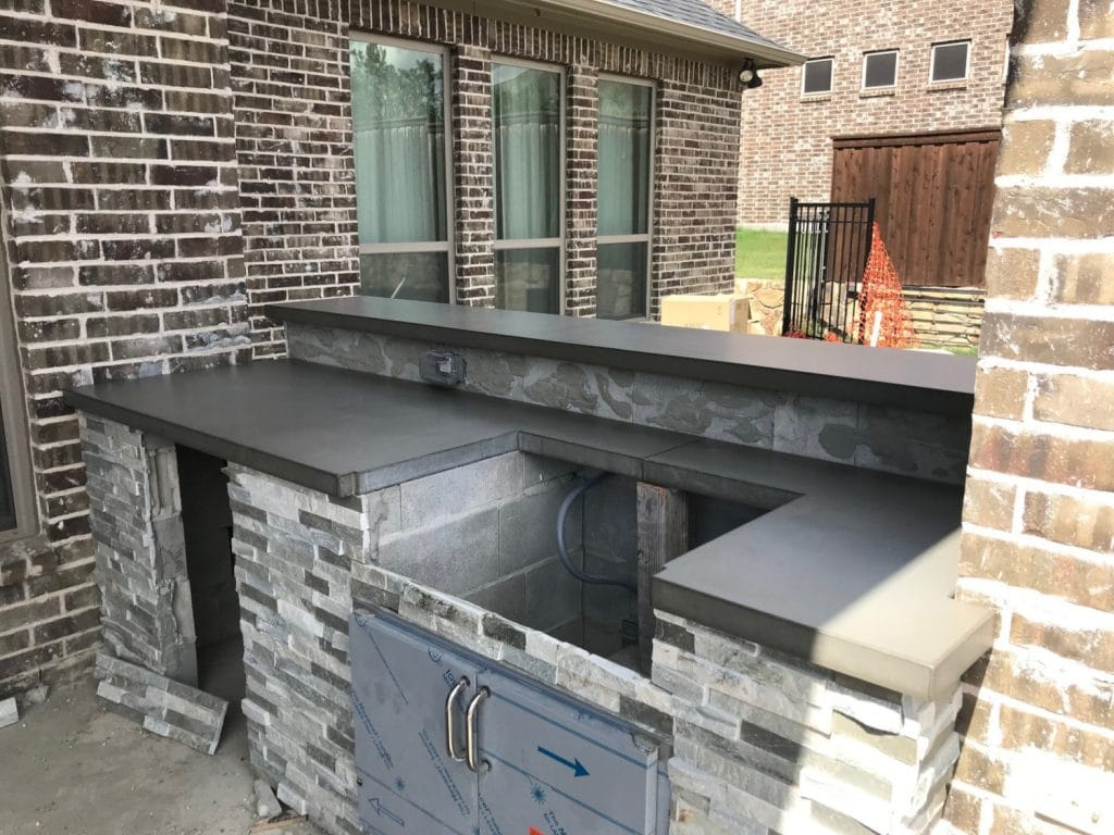 Very Nice Grey Countertop and Wall Topper for a Hauk Custom Pool Outdoor Kitchen