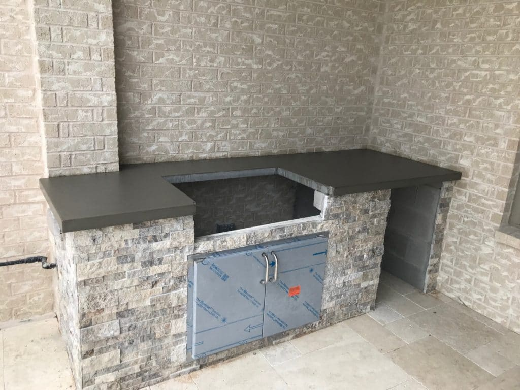 Grey Concrete Countertop for a Hauk Custom Pools Outdoor Kitchen