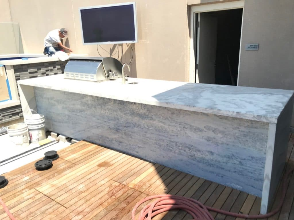 White and Grey Swirled Concrete Countertops for an Outdoor Kitchen for the Pent House Suite