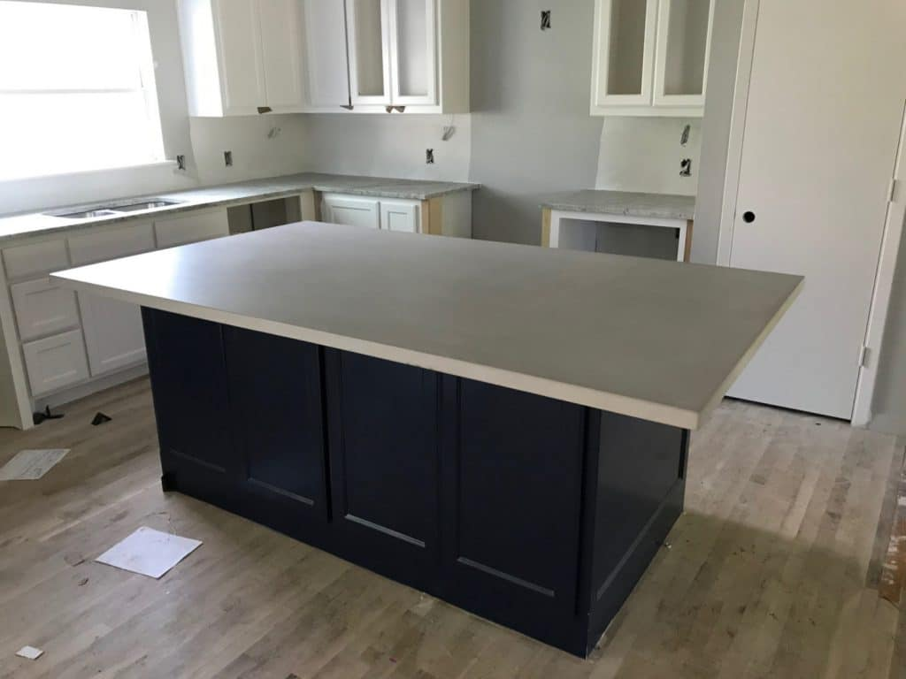 Light Grey Concrete Kitchen Island For a Remodel in Dallas, Tx