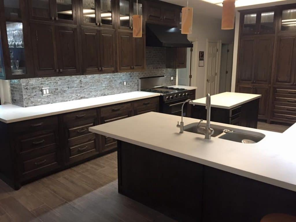 Ebony stained oak cabinets look great with out white concrete countertops.