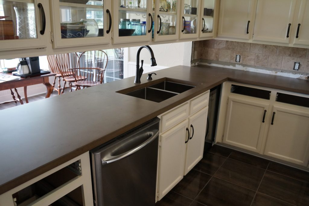 Brown with dark Brown fill, Kitchen Countertops installed in Ponder, Texas. The home owner and her mother were right in there helping the guys with the install. It was a lot of fun.