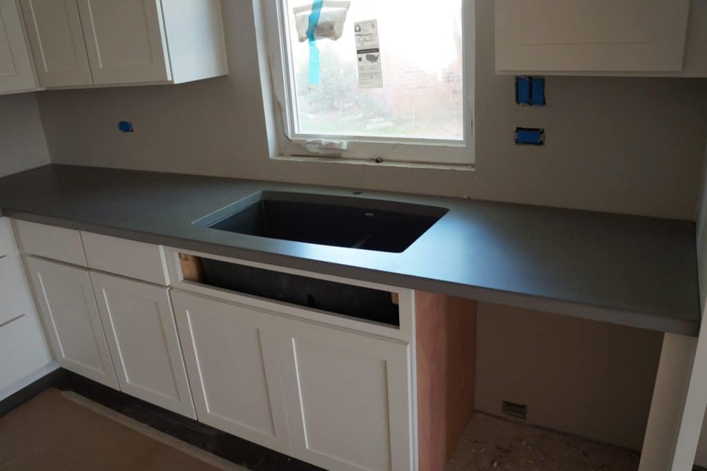 Notice the black composite sink. They're a tight fit in standard kitchen cabinets, but give lots of sink space.
