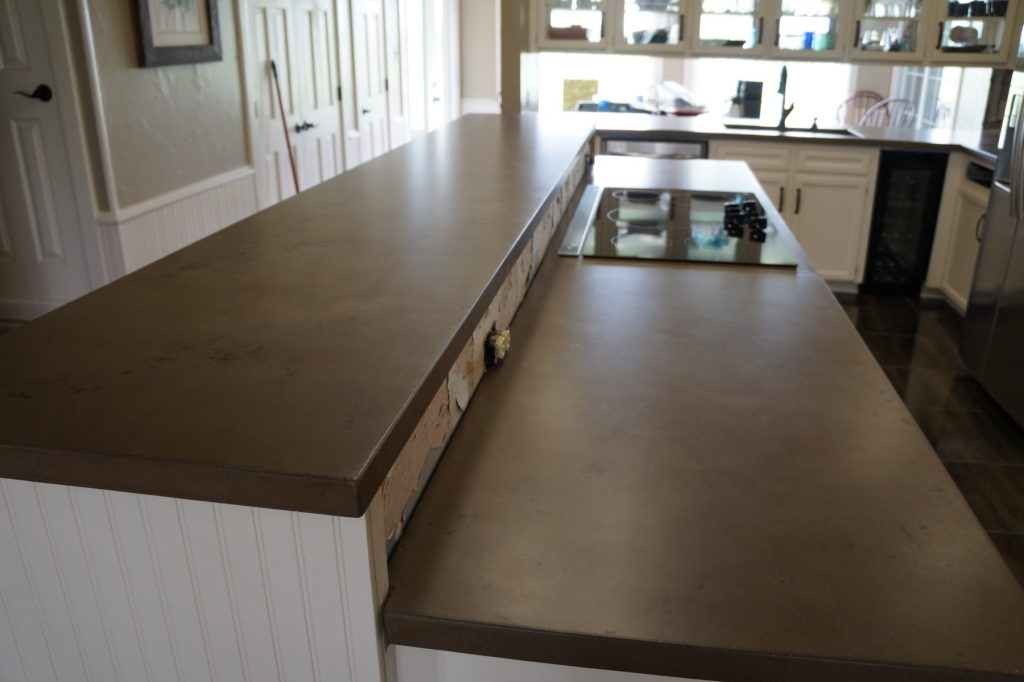 Brown with dark Brown fill, Kitchen Countertops installed in Ponder, Texas. Ten foot bar top, perfect for bar top dancing.