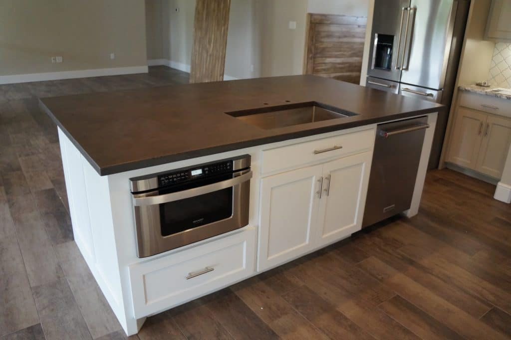 Kitchen Island installed in Decatur, Texas for Mann Made Construction. This is one of our gray finishes with a two-tone effect.