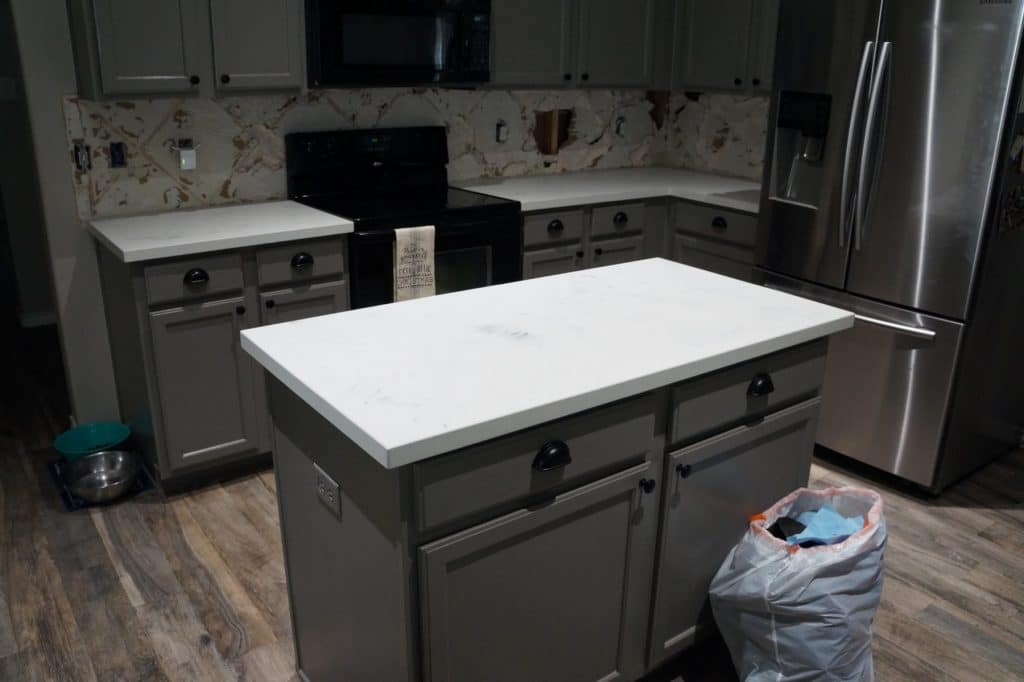 Free bag of trash with every install! Course who would notice with those great looking countertops.