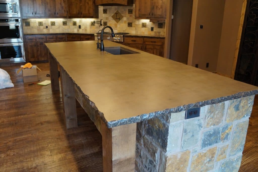 Brown with dark Brown fill Concrete, Kitchen countertops with chiseled edge installed in Montague, Texas. The island was close to 12 feet long and weighed over 1100 lbs.