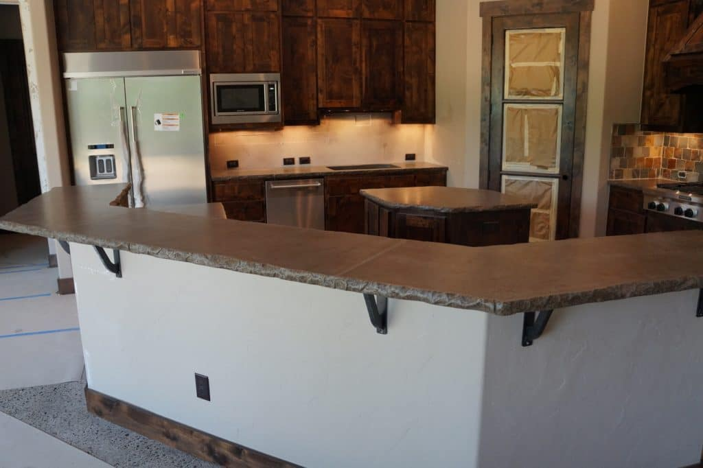 Grey with Brown Fill Concrete Kitchen Countertop with Chiseled edge, installed in Van Alstyne, Texas