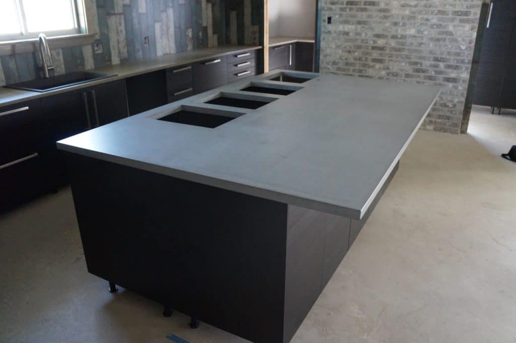 Need a lot of cut-outs in your Concrete Kitchen Island, we know how to do it without cracking the piece. This was installed in Pilot Point, Texas