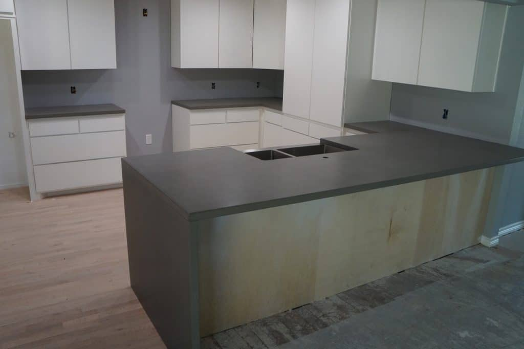 Concrete Kitchen Countertops with Waterfall edge installed in Dallas, Texas