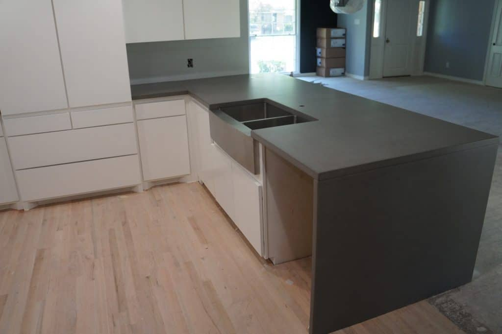Gray Countertops with white cabinets give this newly renovated house in University Park a modern feel.