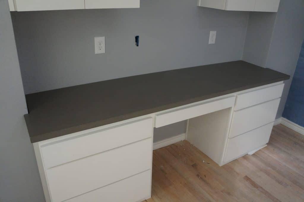 Gray Concrete Desk area right off the kitchen.