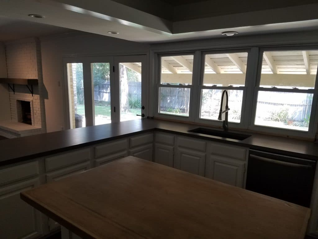 Gray Concrete Countertops installed in Dallas, Texas and yes, the mantle in the background is concrete.