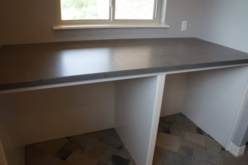 This Concrete Laundry Countertop was installed in Allen, Texas and sits over the washer and dryer, making a convenient folding table.