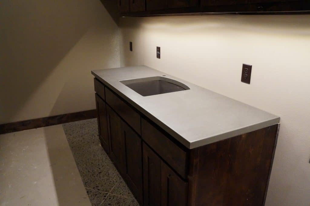 Concrete Laundry Countertop with undermounted composite sink. Installed in Van Alstyne, Texas