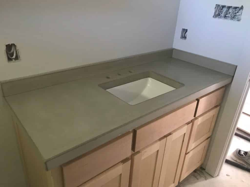 Light Grey Concrete Countertop with Matching Backslash
