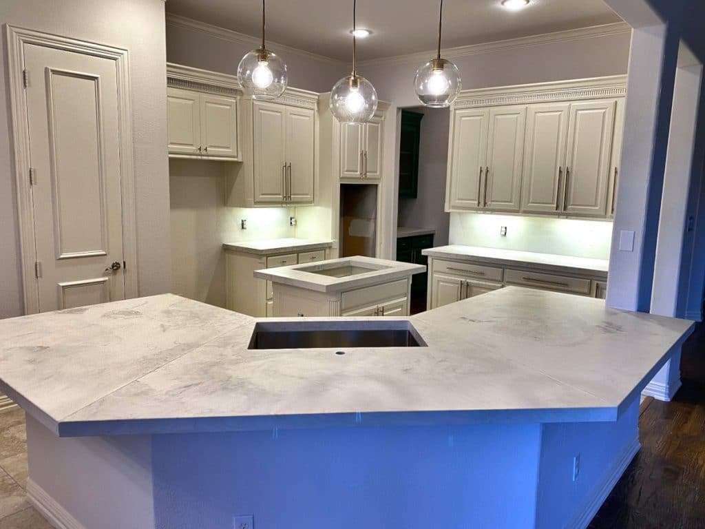 Overview shot of custom white marbled concrete countertops for a kitchen